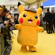 A person in a Pikachu character costume attends the premiere of