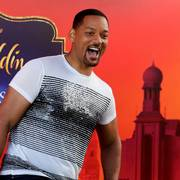 U.S. actor Will Smith reacts during a news conference with director Guy Ritchie and stars Mena Massoud and Naomi Scott, ahead of the regional launching of Disney's live-action