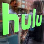 FILE - This June 27, 2015, file photo, shows the Hulu logo on a window at the Milk Studios space in New York. To get a full slate of programming, TV watchers may soon have to subscribe to several services instead of just one or two. Among those options will be services like Netflix and Hulu that offer a wide range of video from a variety of sources; cable-like