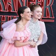 Millie Bobby Brown, left, and Sadie Sink arrive at the season three premiere of