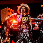 FILE - In this Dec. 9, 2011 file photo, singer RedFoo, center, and LMFAO perform at Z100's Jingle Ball concert at Madison Square Garden in New York. When LMFAO released its sophomore album,