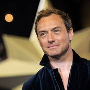 FILE - In this Feb. 27, 2019 file photo, actor Jude Law poses for photographers upon arrival at the premiere of the film 'Captain Marvel', in London. Law is among the readers in an all-star recording of J.K. Rowling's The Tales of Beedle the Bard,