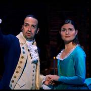In this image released by Disney Plus, Lin-Manuel Miranda portrays Alexander Hamilton, left, and Phillipa Soo portrays Eliza Hamilton in a filmed version of the original Broadway production of