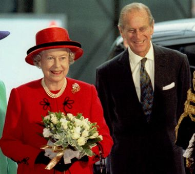 Britain's Queen Elizabeth II and her husband Prince Philip arrive at the Guildhall in the City of London, Wednesday Nov. 19, 1997, to attend a luncheon given by the Lord Mayor of London, Richard Nichols, in honour of the couple's Golden Wedding anniversary. The Queen and Prince Philip celebrate 50 years of marriage on November 20.(AP Photo/pool)