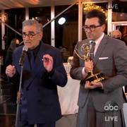 In this video grab captured on Sept. 20, 2020, courtesy of the Academy of Television Arts & Sciences and ABC Entertainment, Annie Murphy, from left, Catherine O'Hara, Noah Reid, Sarah Levy, Karen Robinson, Eugene Levy and Daniel Levy accept the award for outstanding comedy series for