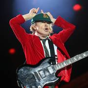 AC/DC lead guitar player Angus Young gestures during the concert of the Australian rock band in Lisbon Saturday night, May 7 2016. On Saturday, AC/DC kicked off the 12-concert European leg of their