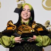 FILE - In this Jan. 26, 2020 file photo, Billie Eilish poses in the press room with the awards for best album and best pop vocal album for