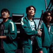 This undated photo released by Netflix shows South Korean cast members, from left, Park Hae-soo, Lee Jung-jae and Jung Ho-yeon in a scene from